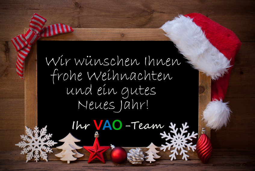 Blackboard With Red Santa Hat And Christmas Decoration like Snowflake, Tree, Christmas Ball, Fir Cone, Star. German Text Danke Means Thank You. Brown Wooden Background